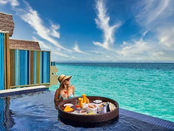 Hard rock hotel maldives platinum overwater pool villa floating breakfast