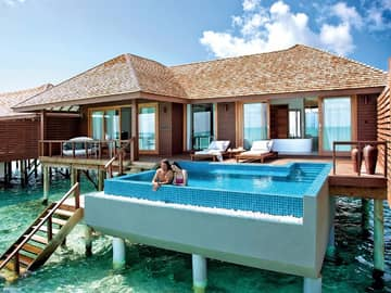 Hideaway beach resort deluxe water villa with pool casal