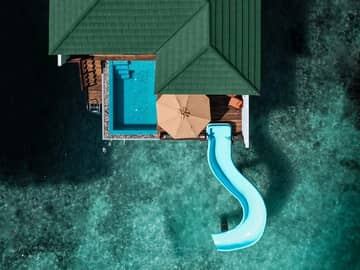 Siyam world maldives villa with pool slide