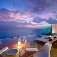Amilla Sunset Water Pool Villa deck