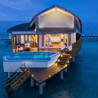 Jw marriott maldives exterior overwater pool villa sunrise