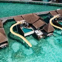 Ozen reserve bolifushi ocean pool suite with slide aereo