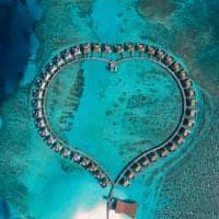 Radisson blu resort maldives water villa vista aerea