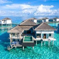 Raffles maldives meradhoo exterior overwater villa