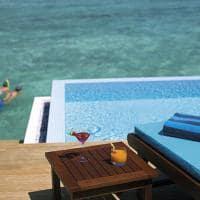 Velassaru maldives water bungalow with pool piscina